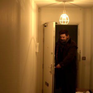Stefan entering through a doorway