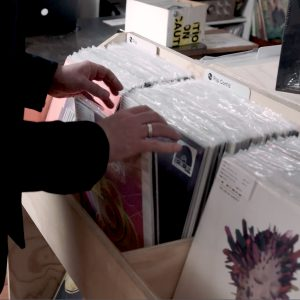 Jeff flipping through vinyl at a record store